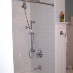 New subway tile shower and Victorian fixtures.