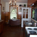 Dark pine paneling, old appliances and more dark pine paneling.