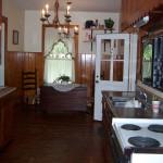 Dark pine paneling, old appliances and more dark pine paneling.