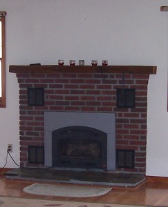 Old gas fireplace with tile hearth.