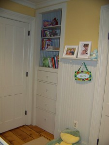 Wasted space in the long closet turned into useful storage.