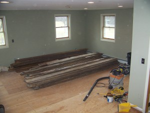 Stacks of old pine flooring