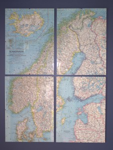 A vintage map cut, framed and displayed in simple glass clip frames