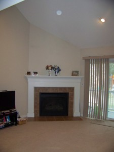 The fireplace before was lost on the empty wall.